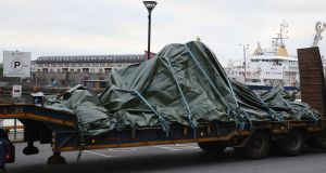 The wreckage of the Irish Coast Guard helicopter  leaves Galway harbour on a flat bed truck. Photograph: Brian Lawless/PA Wire