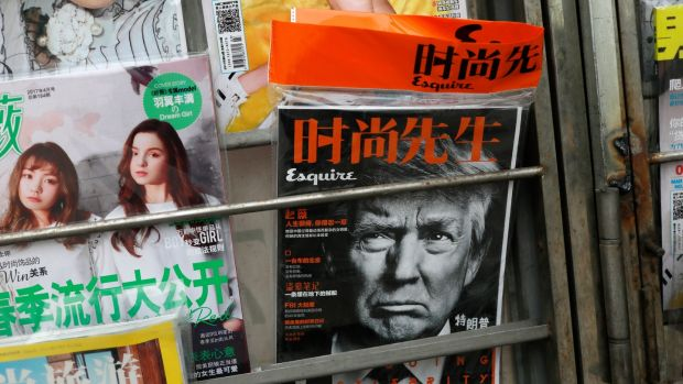 US president Donald Trump on the cover of a Chinese fashion magazine at a news stand in Beijing. Photograph: How Hwee Young/EPA