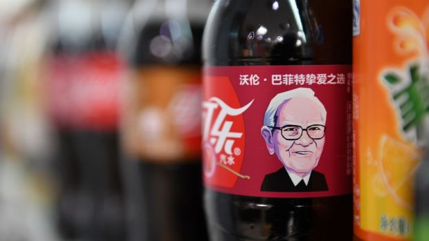 'Sage of Omaha' Warren Buffett is the face of Cherry Coke in China. Photograph: Greg Baker / AFP / Getty Images