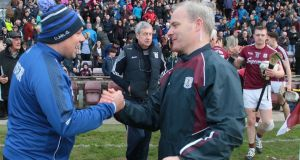 Waterford manager Derek McGrath with Galway's Micheál Donoghue after the quarter-final clash at Pearse Stadium.  Photograph: Mike Shaughnessy/Inpho