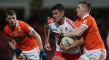 Derry's Jordan Curran is challenged by Armagh's Cathal Boylan and Paul Quinn. Photograph: Lorcan Doherty/Inpho