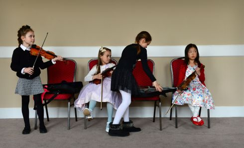 Nadia Siedlarz, Joanna Szlachta, Jagoda Wikar and Eileen Sun, all from Fermata School of Music, Lucan, Dublin were all competing in the Under 9 violin, at the ESB Feis Ceoil, in the RDS in Dublin. Photograph: Dara Mac Donaill / The Irish Times