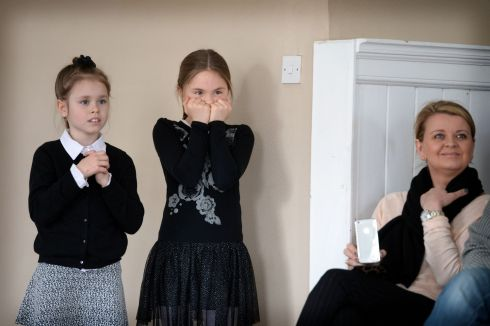 Nadia Siedlarz, (left) and Jagoda Wikar from Fermata School of Music, Lucan, Dublin waiting on results in the Under 9 violin competition, at the ESB Feis Ceoil, in the RDS in Dublin. Photograph: Dara Mac Donaill / The Irish Times