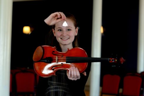Beibhinn Bonham from Dunboyne Co Meath with her medal   in the ESB Feis Ceoil viola competition, yesterday at the RDS.  Photograph: Cyril Byrne / The Irish Times