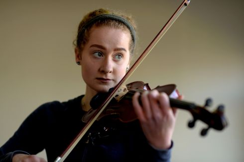 As the 121st Feis Ceoil draws to a close, here are some of the 5,000 contestants from the 32 counties of Ireland who took part. Emily Jane Doyle from Rathgar in Dublin warming up   in the ESB Feis Ceoil violin competition, yesterday at the RDS.  Photograph: Cyril Byrne / The Irish Times