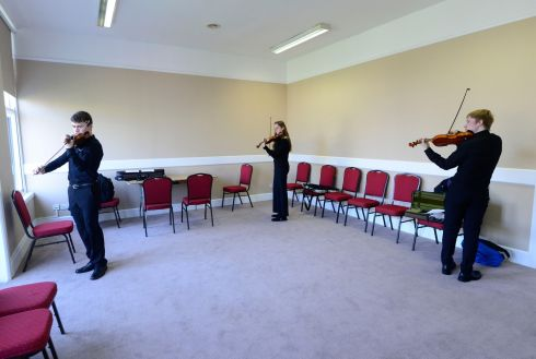 Kevin Jansson, Cork, Kate Fleming, Cork and Senan Moran Laois warming up in the  ESB Feis Ceoil violin competition  at the RDS. Photograph: Cyril Byrne / The Irish Times