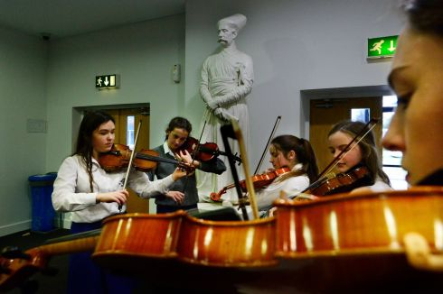 Members of the Loreto Kilkenny Orchestra tuning up  prior to their competition in the Feis Ceoil at the RDS, yesterday.    Photograph: Cyril Byrne / The Irish Times