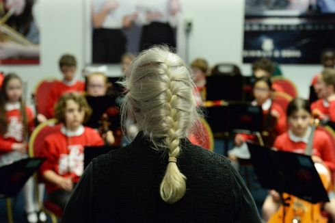 Conductor Margaret Ni Fhaolain preparing   St Canice's Co Ed National School orchestra from Kilkenny  who  performaned in the Feis Ceoil at the RDS.    Photograph: Cyril Byrne / The Irish Times