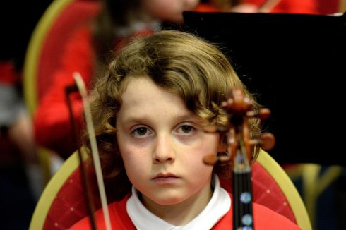 Andrew  Comerford (viola)  in  the  St Canice's Co Ed National School orchestra from Kilkenny  who  performaned in the Feis Ceoil at the RDS.    Photograph: Cyril Byrne / The Irish Times