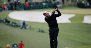 Fred Couples hits his second shot on the first fairway  during the first round at Augusta National. Photograph: Mike Segar
