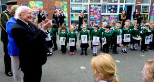 President Michael D Higgins applauds pupils at Scoil Bhríde. Photograph: Cyril Byrne/The Irish Times
