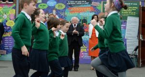President Michael D Higgins looks on as pupils at Scoil Bhride perform a set dance during his visit to celebrate the 100th anniversary of the school's foundation.  Photograph: Cyril Byrne/The Irish Times