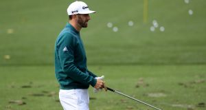 Dustin Johnson of the United States practices on the range prior to his tee time for the first round of the 2017 Masters at Augusta National. Photograph: Getty Images