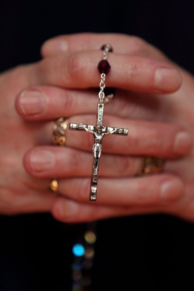 "The 468,400 who answered ""no religion"" are now the second-largest belief grouping after Catholics, and outnumber all other religions combined. Photograph: Cathal McNaughto/Reuters"