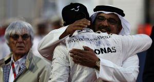 Lewis Hamilton gets a hug from the crown prince of Bahrain ahead of last year's Bahrain Formula One grand prix. Photograph: Getty Images