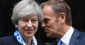 British prime minister Theresa May greets European Council president Donald Tusk in London ahead of Brexit talks. Photograph: Stefan Rousseau/PA Wire