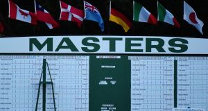 The main leaderboard near the first fairway during the first round of the 2017 Masters at Augusta National. Photograph: Getty Images