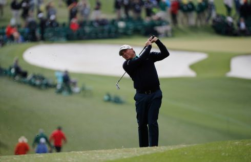 Fred Couples hits his second shot on the first fairway. Photograph: Mike Segar/Reuters