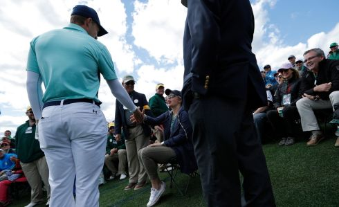 Jordan Spieth shakes hands with patron Haley Voyles after hitting her with his approach shot on the 18th hole. Photograph: Reuters