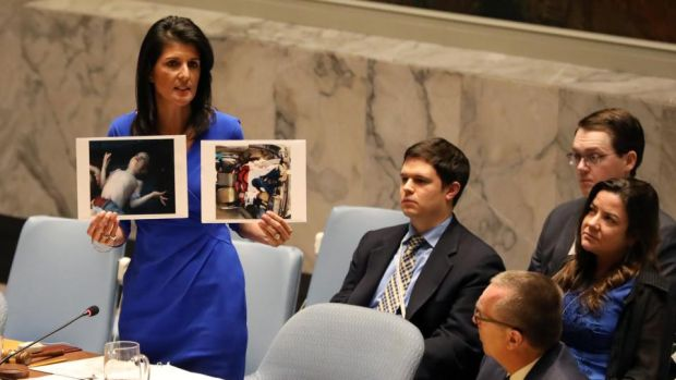 Shayrat retaliation: the US ambassador to the UN, Nikki Haley, shows photographs of gas-attack victims at the Security Council. Photograph: Shannon Stapleton/Reuters