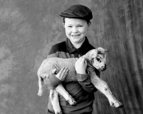 Mark McCann with a new born lamb. Photograph: Therese Foy