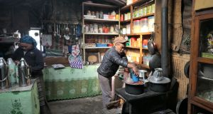 Ang Phurba Sherpa working in the kitchen of his lodge in Marulung.