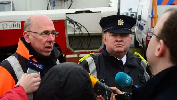 Gerard O'Flynn, operations manager of the Irish Coast Guard, and Garda Supt Tony Healy have pledged to continue the search for the missing crewmen. Photograph: Dara Mac Dónaill