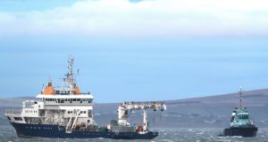 The Granuaile (left) arrives back into Blacksod, Co Mayo, with wreckage from Coast Guard helicopter Rescue 116 onboard. Photograph: Brian Lawless/PA Wire