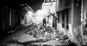 A view of inside of the abandoned barracks near the main train station in Belgrade. People live there in inhumane conditions. Photograph: Szymon Barylski