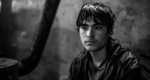 Shaw Khane (15) from Afghanistan. He has been living in the makeshift shelter  for six months. Photograph: Szymon Barylski