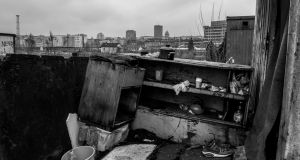 A makeshift outside kitchen in a temporary shelter for migrants, with the city of Belgrade in the background. Photograph: Szymon Barylski