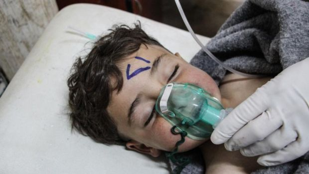 Chemical attack: a Syrian child is treatmed after Bashar al-Assad's regime apparently used nerve gas on civilians. Photograph: EPA Chemical attack: a Syrian child is treatmed after Bashar al-Assad's regime apparently used nerve gas on civilians. Photograph: EPA
