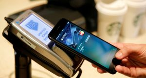 Ulster Bank and KBC have adopted Apple's  contactless payment technology Apple Pay in Ireland.  Photograph: Maxim Zmeyev/Reuters