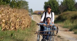 Nujeen Mustafa and her sister Nasrine near the Serbia-Croatia border in  September 2015. Photograph: AFP/Getty