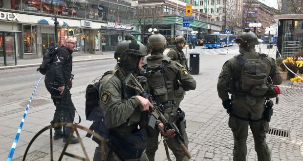 Police officers stand guard in Stockholm  the Åhlens department store into  which a truck ploughed 5b6f22ad6bf44