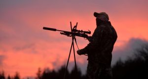 John Lalor at dawn in south Tipperary, heading out on a deer hunt. Photograph: Alan Betson