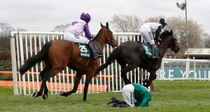 Katie Walsh is unseated from Distime during the  Randox Health Foxhunters Chase. Photograph: Reuters