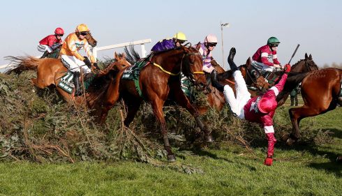 Measureofmydreams (centre) and jockey Donagh Meyler (right) take a fall during the Randox Health Grand National. Photograph: Niall Carson/PA Wire