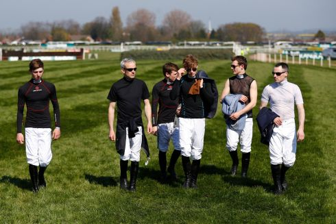 The jockeys walk the course before racing. Photograph: Phil Noble/Reuters