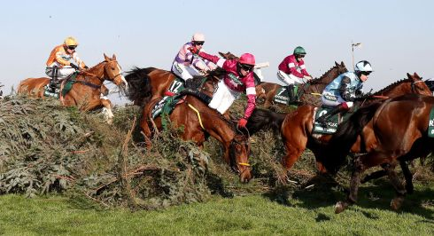 Measureofmydreams (centre) and jockey Donagh Meyler take a fall. Photograph: Niall Carson/PA Wire