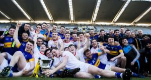 The Tipperary players celebrate after their win over Louth in the Division 3 final. Photograph: Tommy Dickson/Inpho