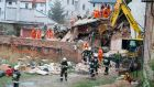 Rescuers search the rubble of a building in Swiebodzice, Poland. Photograph: Natalia  Dobryszycka/AFP/Getty Images