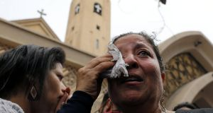 A woman mourns after two explosions killed at least 44 people in Egypt. Photograph: Mohamed Abd El Ghany/Reuters