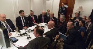 In a photo provided by the White House, Donald Trump and administration figures are briefed on the strike on an air base in Syria at his Mar-a-Lago estate in Palm Beach, Florida. Photograph: Shealah Craighead/The White House via The New York Times