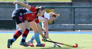 Loreto's Sarah Torrans takes on Rachel Johnston of Harlequins during Loreto's 5-1 victory. Photograph: Rowland White/Inpho