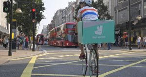 A Deliveroo  document bans the words 'employees', replacing it with 'independent suppliers'. Photograph: Toby Melville/Reuters