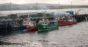 Fishing boats prepare to join the search for missing Rescue 116 crew members Ciarán Smith and Paul Ormsby at Ballyglass Pier, Belmullet, Co Mayo. Photograph: Keith Heneghan/ Phocus