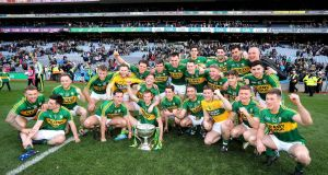 Kerry celebrate with the trophy after defeating Dublin by a point in the Allianz League final at Croke Park. Photograph: Ryan Byrne/Inpho