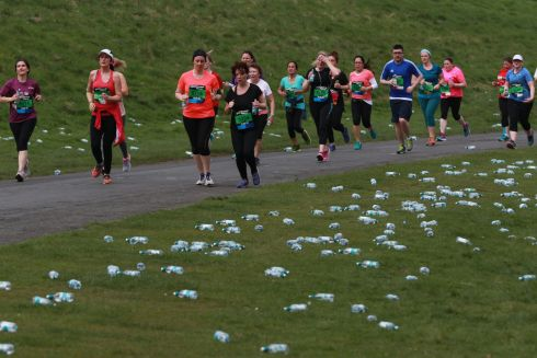 The Great Ireland Run in Dublin's Phoenix Park.  Runners passing discarded water bottles during their run.  Photograph Nick Bradshaw