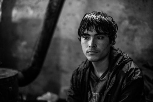 15 years old Shaw Khane from Afghanistan. For 6 months he has been living in the makeshift shelter near the main train station in Serbia, Belgrade